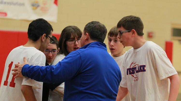 Members of the West Lake All-Stars huddle up around their coach, Asst. Principal Tim Powers, during their game against Crown Point.  After a lot of back and forth, the All-Stars lost the game 36-34.