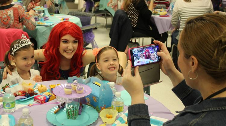 """Cast and crew of """"The Little Mermaid"""" dress up as Disney characters to have tea with princesses and princes of Lake County. The tea party ended with a showing of """"The Little Mermaid."""""""