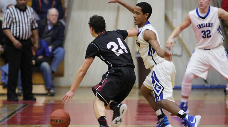 Joseph Graziano (11) fights to protect the basket. Graziano led the team in assists.
