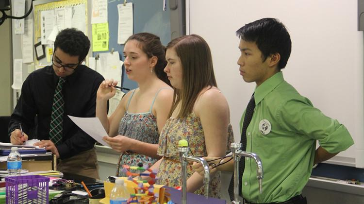 Jay Chopra (12), Samantha McCuaig (12), Madelyn Ackerman (12) and Matthew Tao (12) prepare to start the Science Olympiad meeting. This was their final meeting before State.