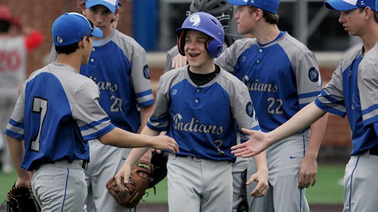 Benjamin Bosold (9) gets congratulated after making it home. The game started at 4:30 p.m.
