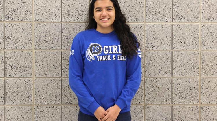 Jasmine Reyes (10) sports a track and field shirt.  Reyes is currently on the girls track and field team.