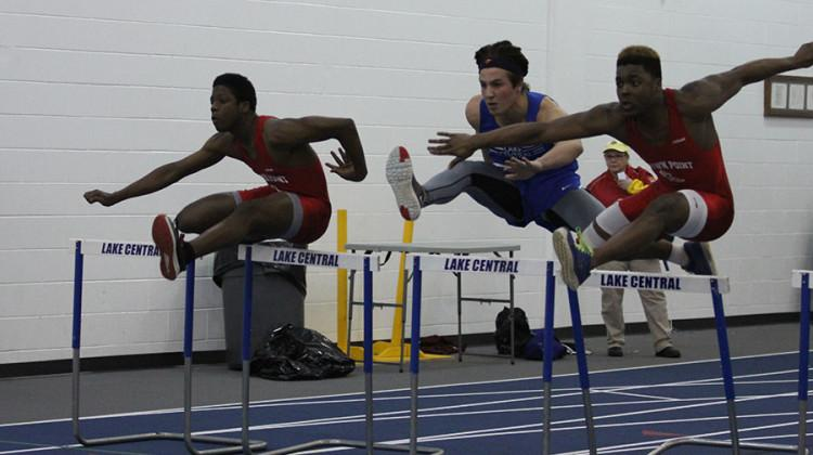 Nicholas Lucas (11) hurdles during the indoor boys track and field meet against Crown Point. The boys continue their season this year in hopes for good weather for the outdoor season.