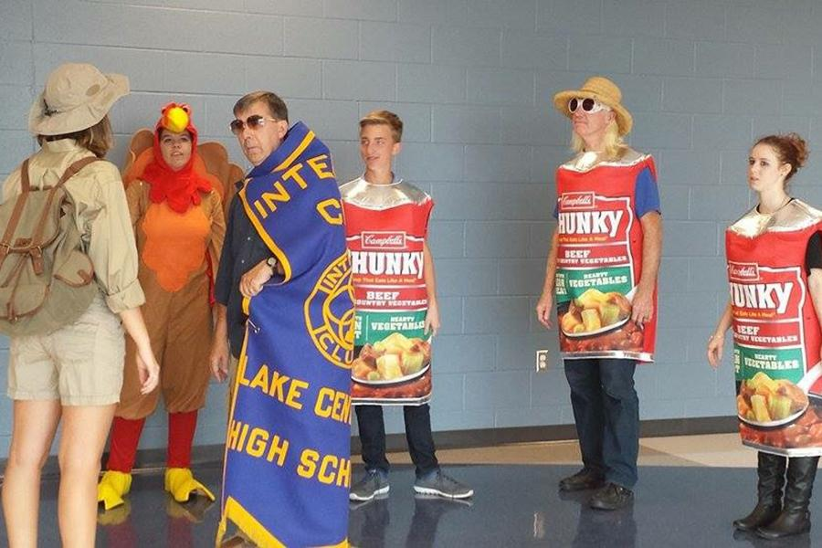 Mr. Tom Clark, Social Studies, Mr. Ron Fredrick, English and several Interact members prepare to film the 2016 Food Drive commercial. The Food Drive was one of many Interact projects carried out this year and has been a tradition for nearly three decades at Lake Central. Photo submitted by: Duaa Hijaz (12)