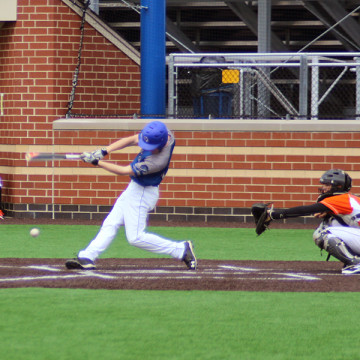 Raymond Hilbrich (10) hits a ball during the game. The boys lost 3-1.