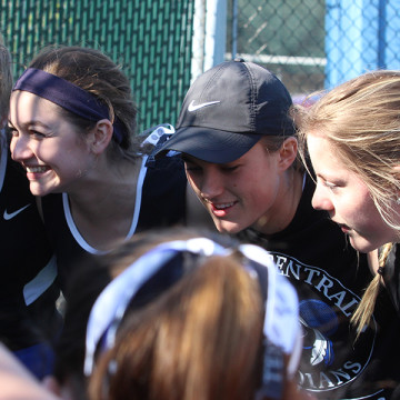 Claire Gronek (10), Lauren Gronek (11), Kristina Tinsley (11) and Sky Martens (11) gather next to each other in a team huddle before a match. The varsity players have grown close throughout the  season.