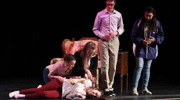 "Jane Wright (9), Morgan Kobisch (9), Max Galocy (9) and Gabriella Hay (9) look down at Olivia LaVoie (9) as her character, Mrs. Teal, faints during their production of ""Suspect To Change."" Elise Bereolos (12) and Adam Gustas (11) directed this play about a misunderstanding between friends that turns into a crime."