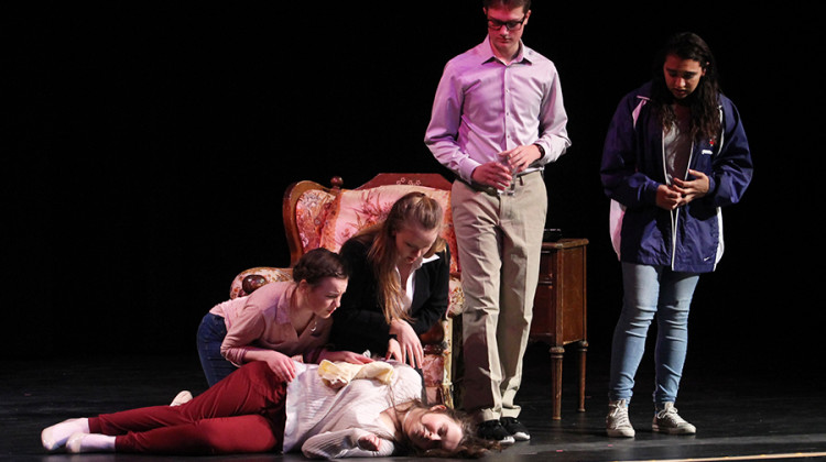 """Jane Wright (9), Morgan Kobisch (9), Max Galocy (9) and Gabriella Hay (9) look down at Olivia LaVoie (9) as her character, Mrs. Teal, faints during their production of """"Suspect To Change."""" Elise Bereolos (12) and Adam Gustas (11) directed this play about a misunderstanding between friends that turns into a crime."""
