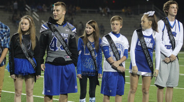 Jackson Long (10) stands with other homecoming court nominees during the homecoming game. Long was one of the Sophomore nominees that teachers voted for.