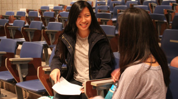 Anna Hallowell (11) discusses the meeting agenda with Ruth Chen (11). Chen is the Vice President of the DFS club for the next school year.