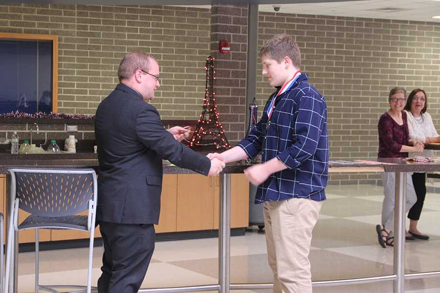 Thomas Pavell (9) receives his medal. This was Pavell's first year taking the National French Exam and he placed in the silver level nationally.
