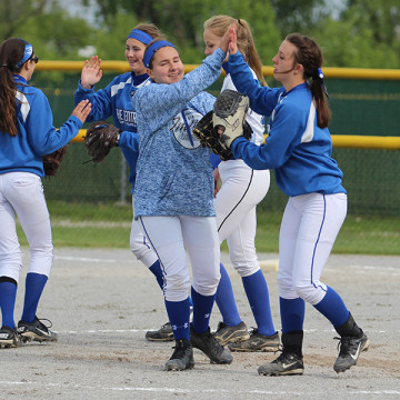 Girls from the JV softball team congratulate each other. The girls felt that their season went exceptionally well.