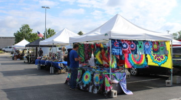 Vendors setup their booths and sell their goods to customers at the St. John Farmer's Market. The market opened for the year on Sunday May 1.