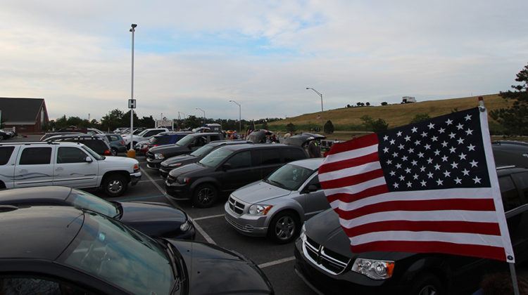 Vehicles are parked while people gather in Centennial Park. The people were gathering at Munster's annual Independence Day Celebration on Sunday, July 3.