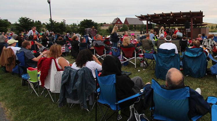 "Family and friends gather to listen to music. The band playing was called ""Classical Blast."""