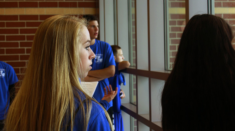 Taking in the third floor views, Julia Jacobson (9) gets comfortable with her home for the next four years. The Class of 2020 was invited to Freshman Rush so they could get oriented with the school before the first day.