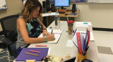 Mrs. Andrea Leahy, Mathematics, writes her agenda for the week. Leahy is Lake Central's newest geometry teacher.
