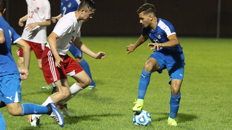 Naser Tahahwah (12) plays the ball. The Indians won with a score of 5-1 against the Crown Point Bulldogs.
