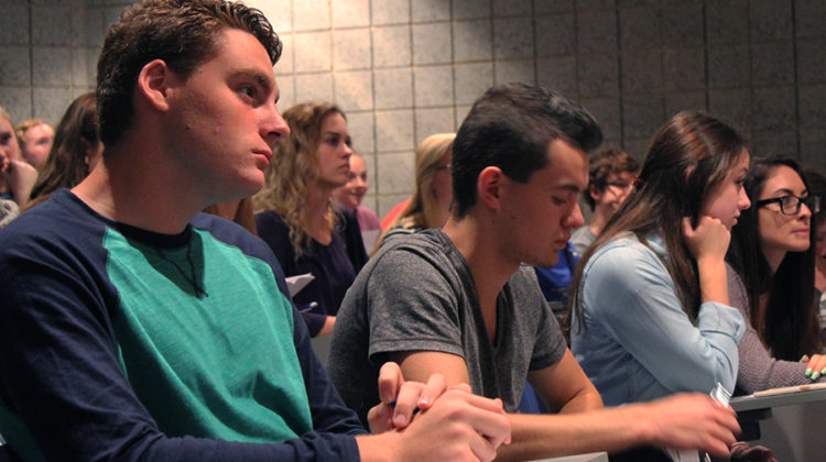 Listening attentively, Jacob Densen (12) is informed about the upcoming blood drive. The next NHS meeting is Thursday Oct. 6.