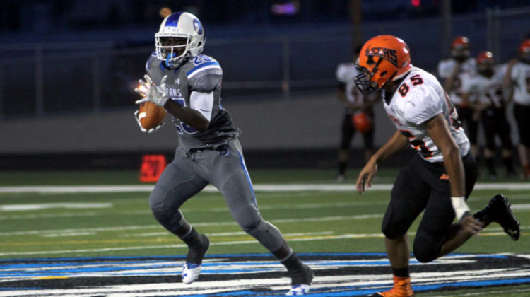 Anthony Giles (12) runs the ball down the field to gain yardage. Giles rushed 170 yards on 22 carries Friday night.