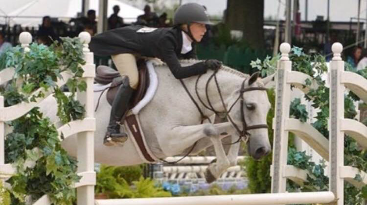 Kylie Fabisiak (10) rides her horse Emmett at nationals. Fabisiak has been riding horses for 10 years. Photo submitted by Kylie Fabisiak
