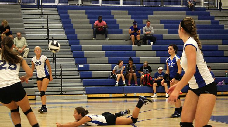 Mallory Uzelac (10) dives for the ball to keep the play alive.  Mallory popped the ball up to continue the rally.
