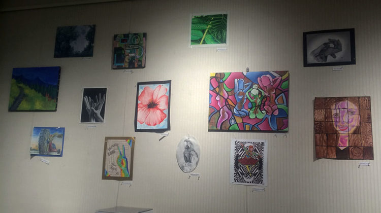 Works of art hang on the walls of the library's art gallery.  Art​ was painted by students at Lake Central.
