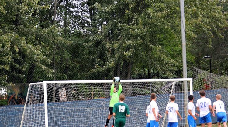 Marcus Orciuch (10), the JV goalkeeper, jumps and saves a free kick made by Valparaiso. The boys won the game 2-1.