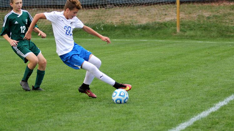 Robert MacNeill (9) wins the ball from Valparaiso player. He scored the first of two goals.
