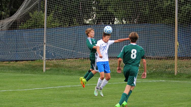Jack Egnatz (10) hits the ball with his head to bring it to his feet. This is Jack's second year on JV.