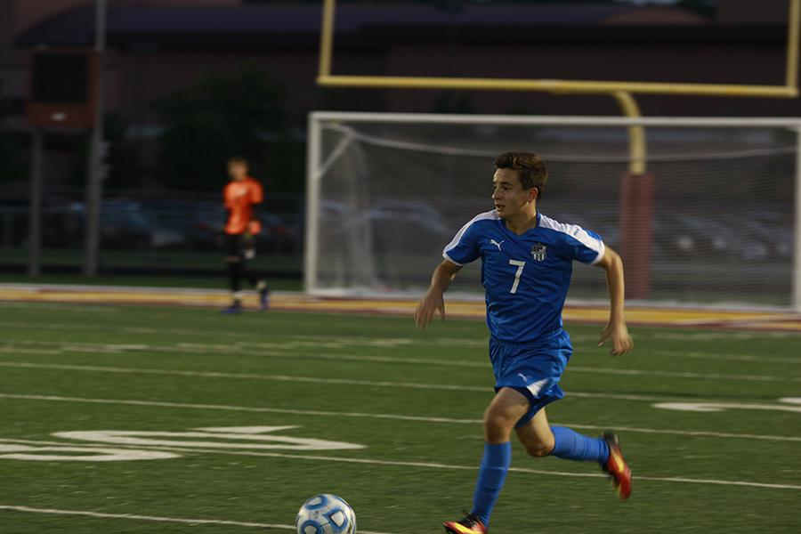 Diego Ruiz-Avila (12) dribbles the ball down the field. He looked to make a pass to a fellow teammate.