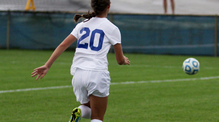 Cevanah Brazzale (10) advances toward the goal, hoping to score. Brazzale got the ball in her possession.