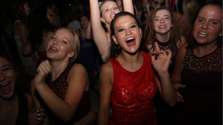 Madeline Andrews (11) dances with her group of friends at the Homecoming dance. Andrews was one of the many students on the dancefloor.