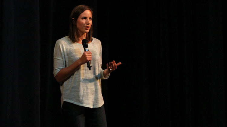 Katie, the third and final speaker of the Stairway to Heroin presentation, shares her own story about drug addiction. The three speakers addressed the importance of staying alert about the dangers of substance abuse and addiction on Tuesday, Oct. 11 in the auditorium.