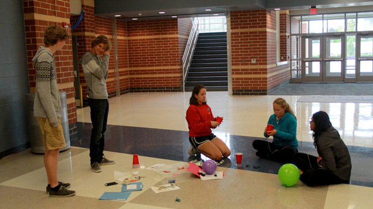 Students perform an experiment called Halloween tricks. These tricks implemented scientific principles in fun experiments.