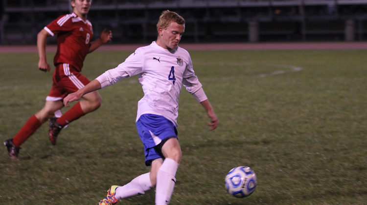 Michael Bikos (11) prepares to kick the ball. Bikos played as a forward for the Indians.