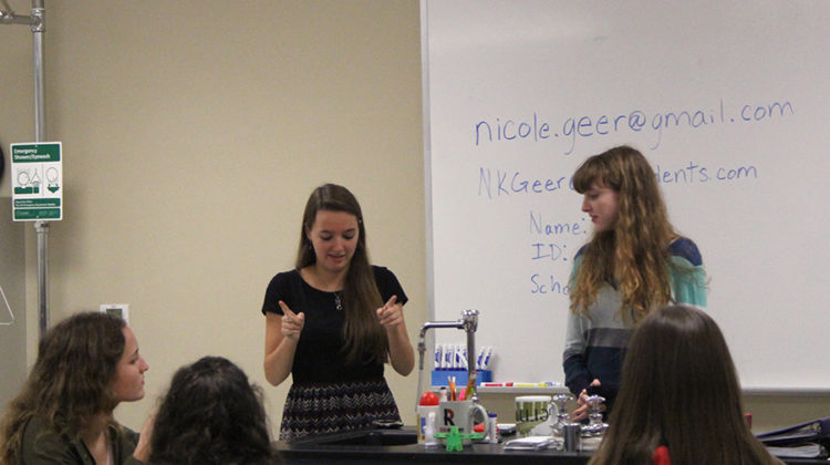 Nicole Geer (12) and Rachel Kozel (12) discuss possible upcoming events. They are the leaders of WISE.