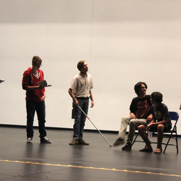 Emily Badger (12), Adam Kharchaf (12), Zachary Hansen (12), Alexander Vrbanoff (11), Ben Morris (11) and Olivia Throckmartin (11) rehearse the first scene of the play. The first show is scheduled to be held on Oct. 25 for the elementary schools and the first one for the general public is Nov. 5.
