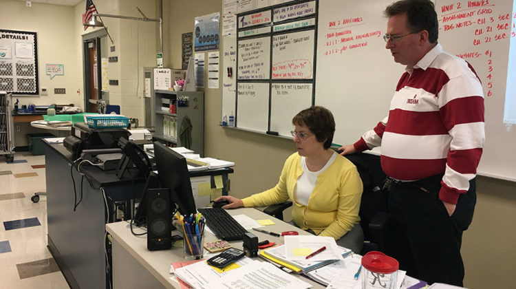 Mr. David Harnish, Science, and Mrs. Roberta Harnish, Science, look over their October schedule together. The Harnishs had been married for 22 years and taught chemistry classes next door to each other.