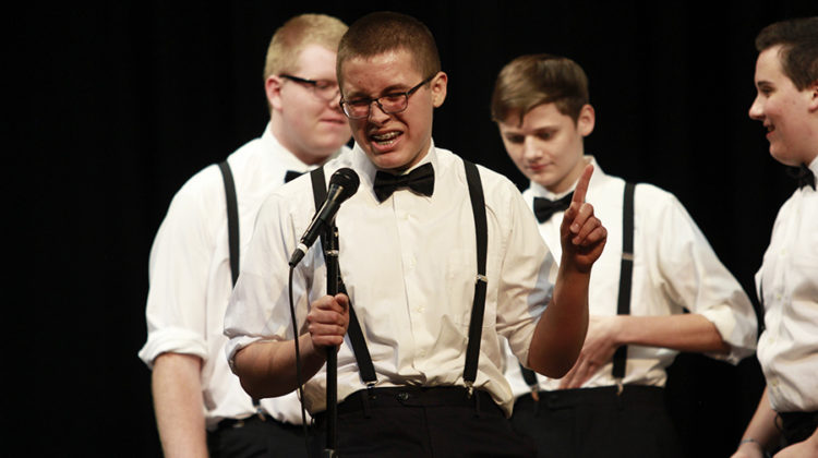 "Da Capo member Caleb Zapata (11) sings with soul at the choir concert during the song ""Little Darlin'."" Zapata is also a member of the Concert Choir."