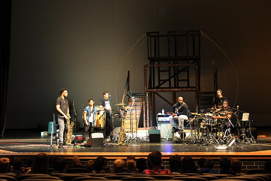 Drummer Robert Searight talks to the students. Robert wrote most of the band's music.