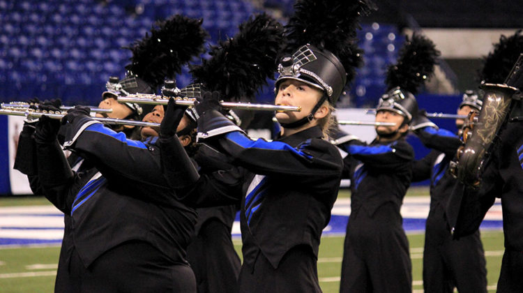 Emily Gibson (11) plays the flute during the Lake Central Marching Band's performance of Silver Lining. The band has been practicing Silver Lining since May.