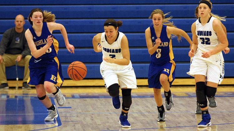 Faith Maldonado (12) runs down the court after a loose ball. Maldonado played point guard for the majority of the game.
