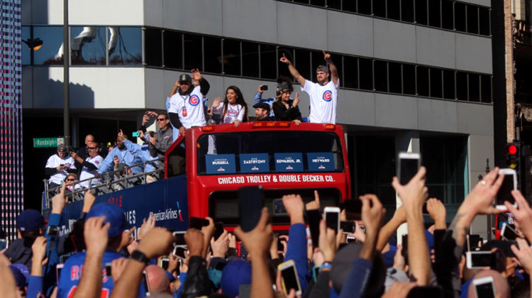 Cubs players cheer on with the fans while going down Lakeshore Drive. The parade consisted of five million cubs fans. Photo by: Jessica Cook (11)