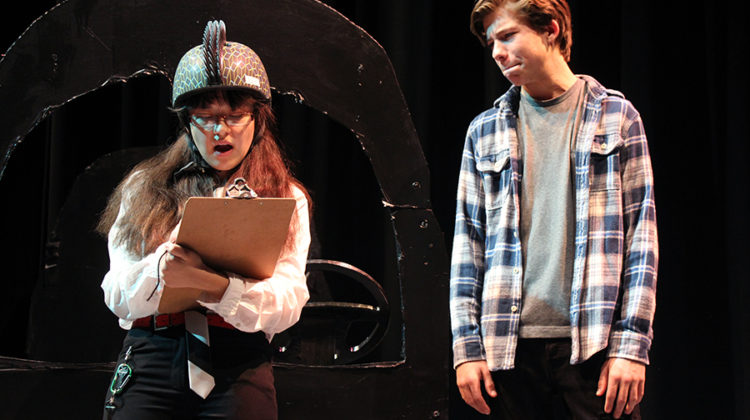 "Elise Halbe (10) and Connor Ryan (10) act in ""You're Driving me Crazy."" The duo played a nervous driving instructor and hesitant new driver. Photo by: Abigail Hines (12)."