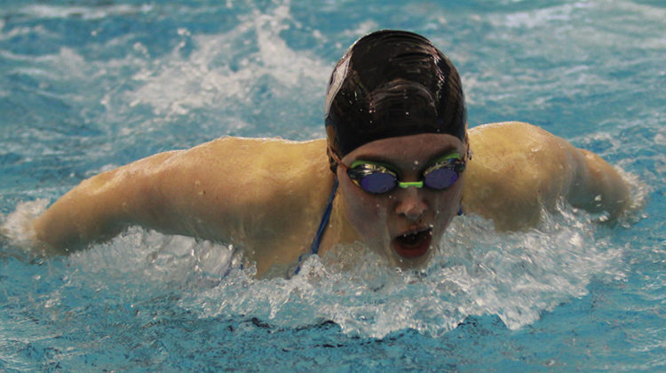 Julianna Massa (11) competes in breaststroke. She was named team captain at the beginning of the swim season.