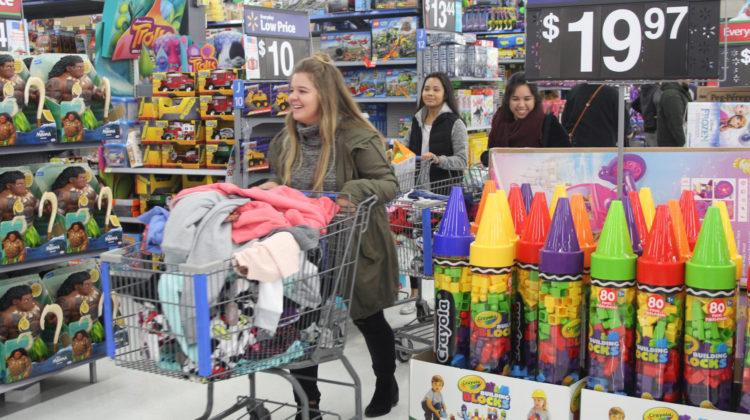 Allison Schuch (12) wheels past the toy section with a cart full of clothes. Schuch was the group leader of the 9-10 year olds.