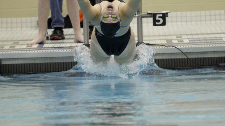 Jillian Murray (10) reaches backwards after hearing the sound to start backstroke. Murray was placed first in three of her four events.