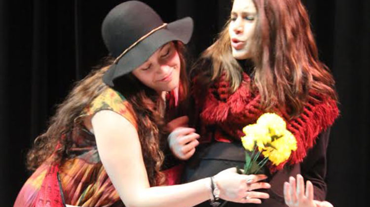 Erica Habas(10) and Natalie Bivona(10) star in one of Advanced Theatre's student directed shows. They perform the play While their teacher, Pamela Neth, grades them.