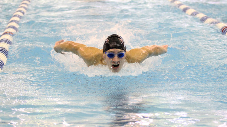 Jack Tinsley (10) is swimming butterfly style. Tinsley swam the 200 IM.